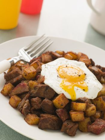 Corned Beef Hash with a Broken Fried Egg and Black Pepper