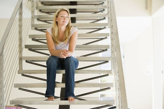 Woman sitting on stairs