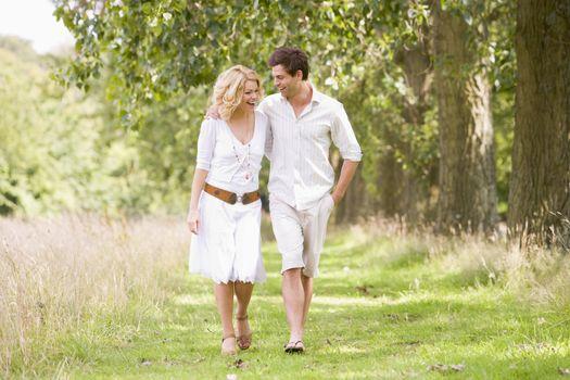 Couple walking on path smiling