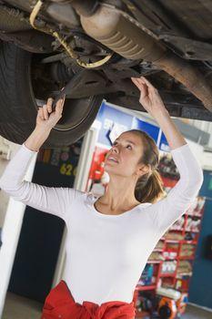Mechanic working under car