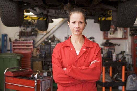 Mechanic standing in garage