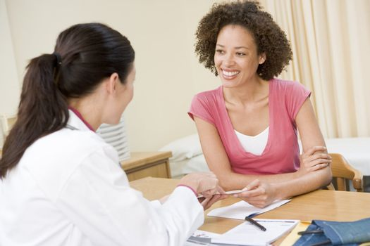 Woman in doctor's office smiling