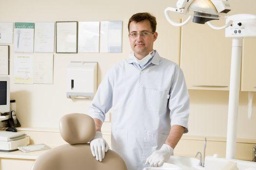 Dentist in exam room smiling