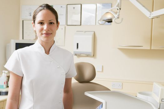 Dental assistant in exam room