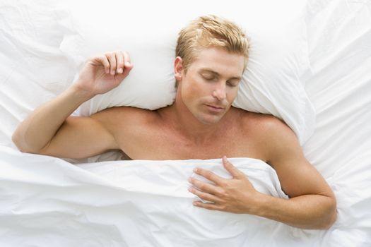 Man lying in bed sleeping