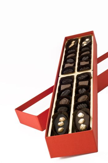 red box of chocolates on white background