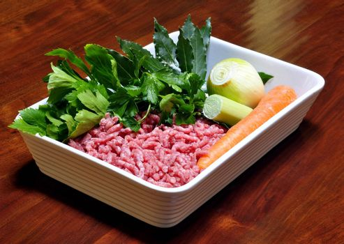 raw minced beef with carrots, parsley and onion