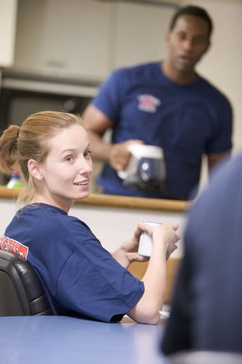 Firefighters relaxing in the staff kitchen