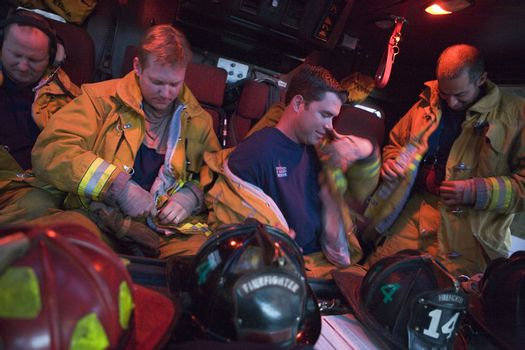 Firefighters preparing for an emergency situation