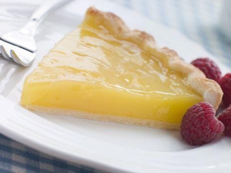 Slice of Lemon Curd Tart with English Raspberries