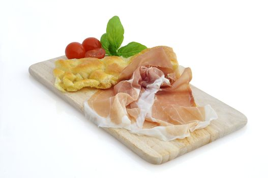 tomatoes ,ham and basil leaves on a white background
