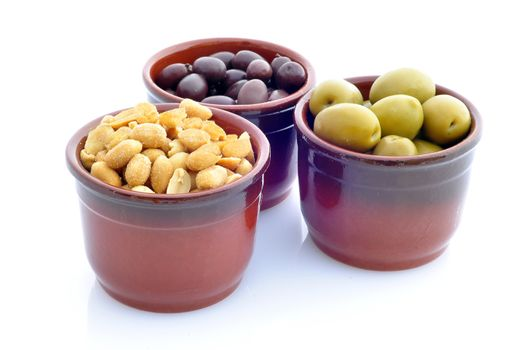 containers with olives and peanuts on a white background