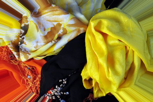 fabrics of different colors, decorated with pearls and fancy