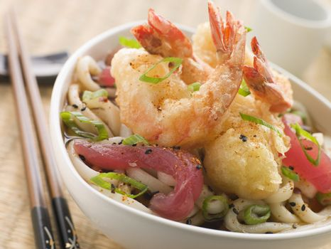 Bowl of Tempura Tiger Prawn and Udon Noodle Broth with Yellow Fi
