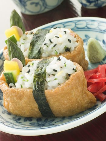 Opened Bean curd Pouches with Citrus Sushi Rice Vegetables Wasab