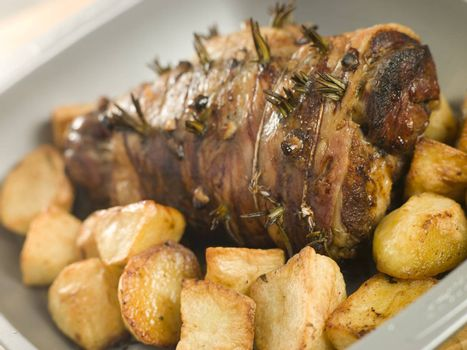 Roast Leg of Lamb Studded with Garlic and Rosemary and Roast Pot