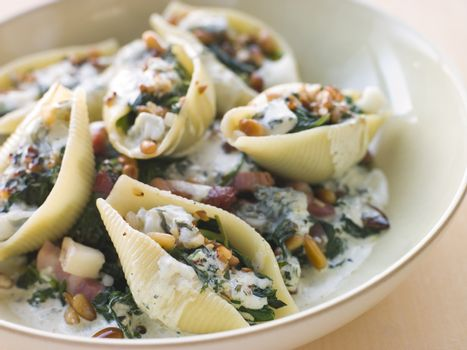 Conchiglioni pasta shells with Spinach Pancetta Pine Nuts and Go