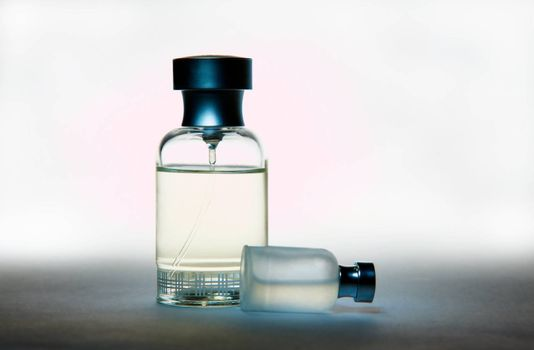 Two perfume bottles, on gradient background