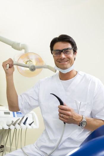dentist turning on examination light