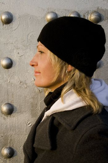 The blonde on a background of a silvery wall