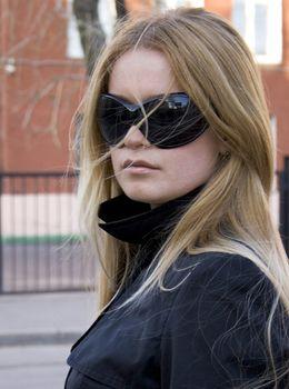blonde in sunglasses