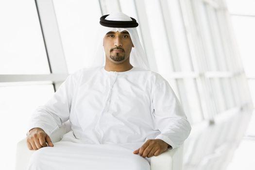 Man sitting indoors smiling