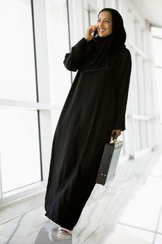 Businesswoman walking in a corridor