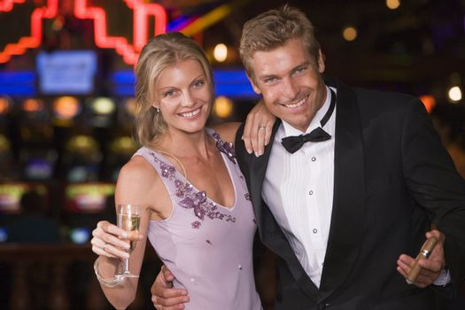 Couple in casino with cigar