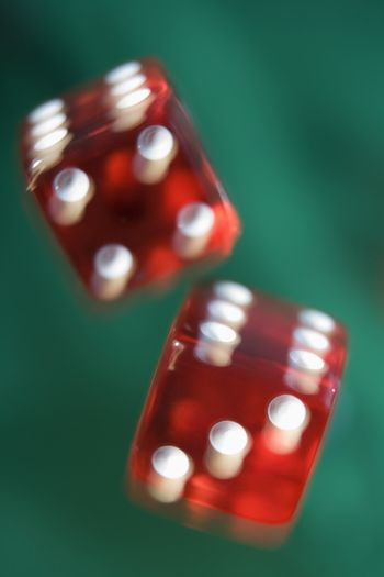 Dice rolling on a poker table