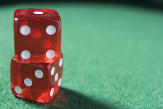 Dice sitting on a poker table