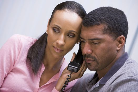 Couple listening to news over phone