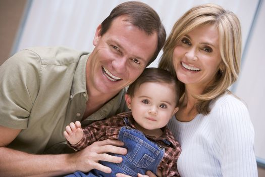 Mother and father with young son at home