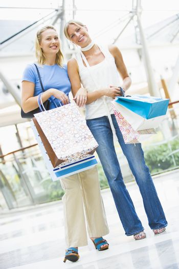 Friends shopping mall carrying bags