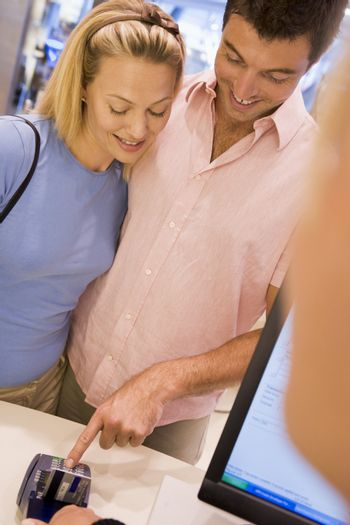 Couple making purchase in store