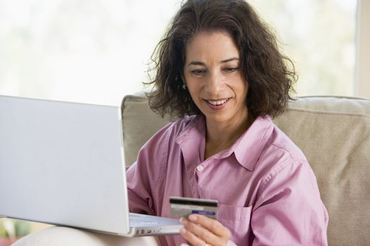 Woman making online purchase at home
