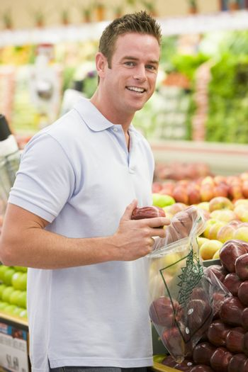 Man shopping in produce section