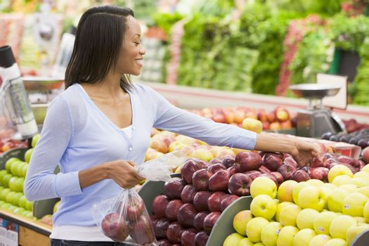 Young woman shopping in produce section