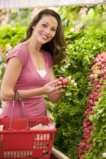 Woman shoppping in produce section