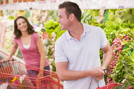 Couple flirting in supermarket