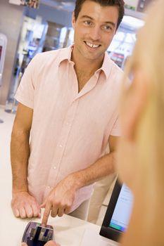 Man entering security details for credit card transaction