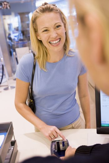 Woman entering security details for credit card purchase