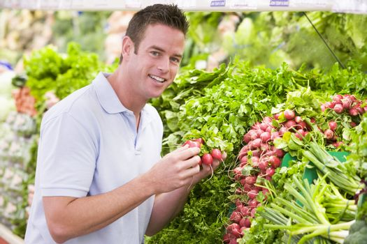 Young man shopping for fresh produce