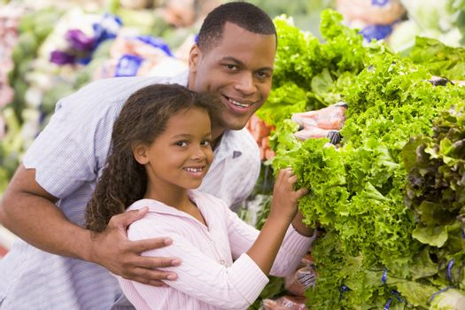 Father and daughter buying fresh produce