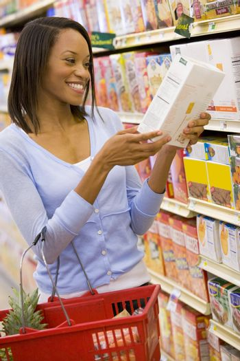 Young woman grocery shopping
