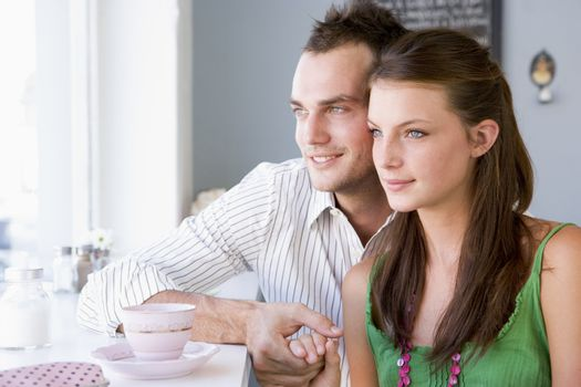 Young couple having a cold drink in a cafeteria