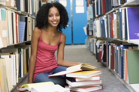 University student working in library