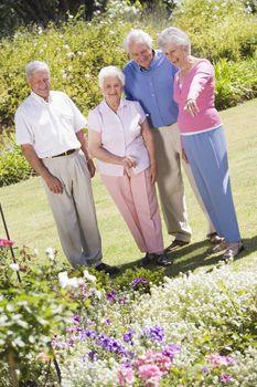Two senior couples in a flower garden