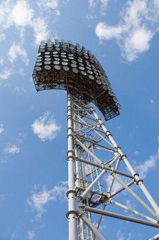 stadium light tower against a blue sky