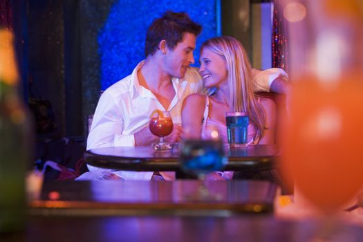 Young couple in a bar