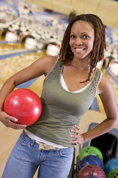 Woman at a bowling lane